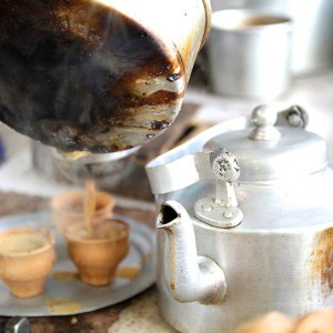 Steaming cups of chai being poured into kulhars (clay cups) - a monsoon necessity