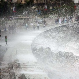 Waves crash on to Marine Drive in Mumbai during the high tide of the monsoon